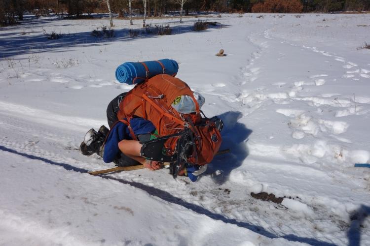 Oh solid ground - Thank goodness! Jake kissing ATV tracks.